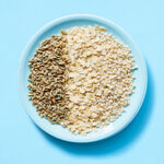 Bowl of grains on blue background.